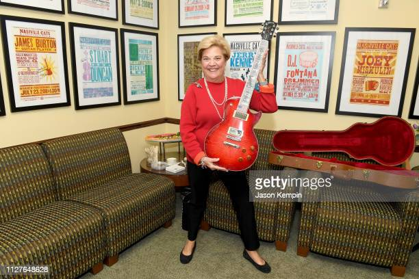 Honoree Bebe Evans poses for photos with her Gibson guitar during the Twelfth Annual Louise Scruggs Memorial Forum honoring Bebe Evans and Marcie...