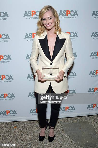 Honoree Beth Behrs poses with her Compassion Award at ASPCA's Los Angeles Benefit on October 20 2016 in Bel Air California