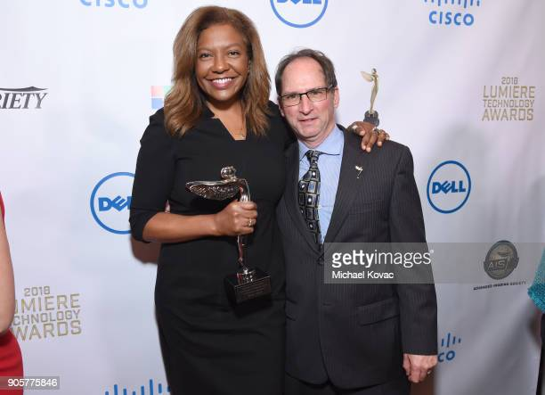 Honoree Bettina Sherick and The Advanced Imaging Society Marketing Events and Operations SVP Michael Madnick pose with the Distinguished Leadership...