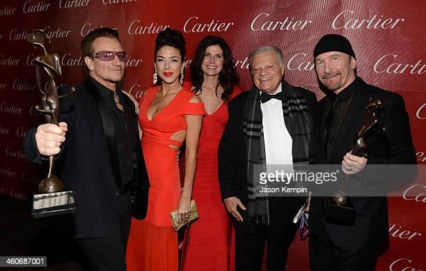 Honoree Bono of U2 Chianna Maria Bono Mary Bono Mack Palm Springs Film Festival Chairman Harold Matzner and honoree The Edge of U2 pose with the...