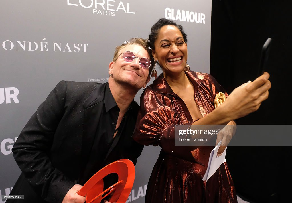 Honoree Bono, recipient of the Man of the Year award (L), and host Tracee Ellis Ross pose for a selfie photo during Glamour Women Of The Year 2016 at NeueHouse Hollywood on November 14, 2016 in Los Angeles, California.