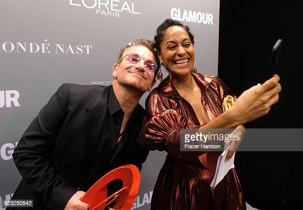 Honoree Bono, recipient of the Man of the Year award , and host Tracee Ellis Ross pose for a selfie photo during Glamour Women Of The Year 2016 at...