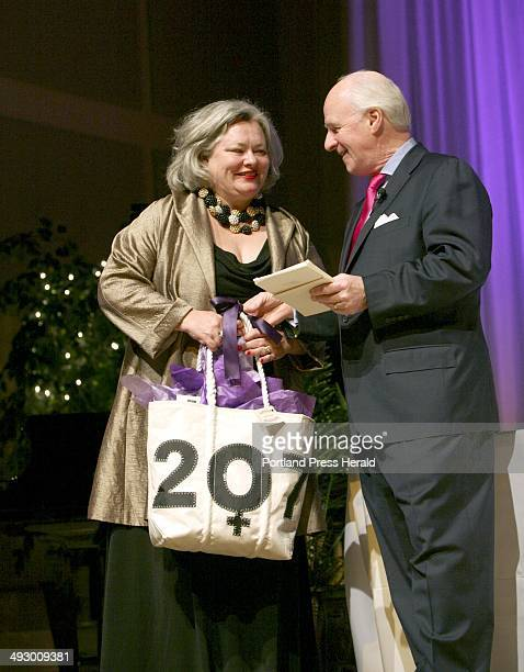 Honoree Brenda Garrand receives her gifts from Richard Connor editor and publisher of Maine Today Media during the Great Women of Maine ceremony at...