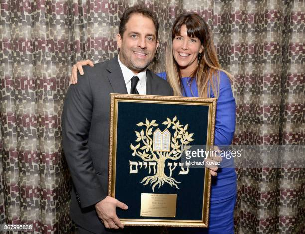 Honoree Brett Ratner and Patty Jenkins pose with the Tree of Life Award during the Jewish National Fund Los Angeles Tree Of Life Dinner at Loews...