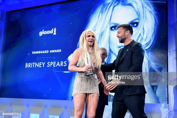 Honoree Britney Spears accepts the Vanguard Award from Ricky Martin onstage at the 29th Annual GLAAD Media Awards at The Beverly Hilton Hotel on...