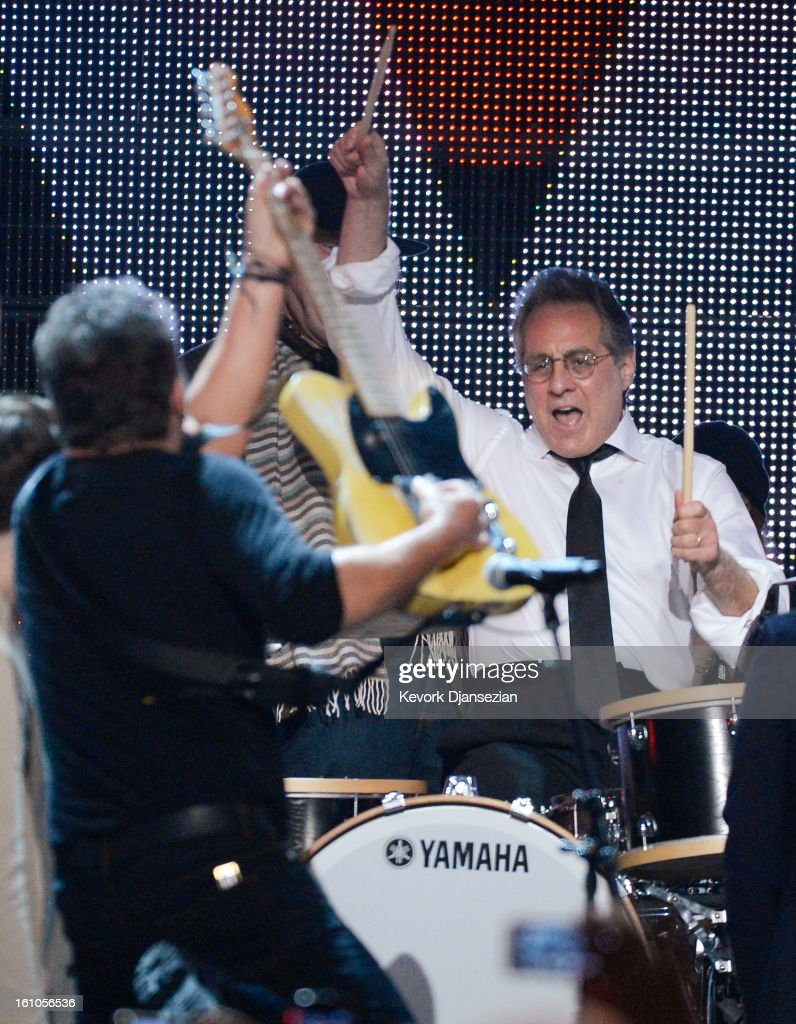 Honoree Bruce Springsteen (L) and drummer Max Weinberg perform onstage at The 2013 MusiCares Person Of The Year Gala Honoring Bruce Springsteen at Los Angeles Convention Center on February 8, 2013 in Los Angeles, California.