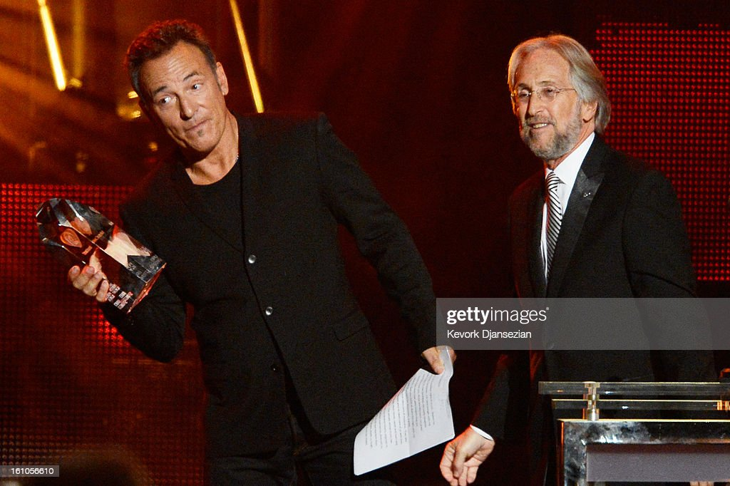 Honoree Bruce Springsteen (L) and NARAS President Neil Portnow speak onstage at The 2013 MusiCares Person Of The Year Gala Honoring Bruce Springsteen at Los Angeles Convention Center on February 8, 2013 in Los Angeles, California.