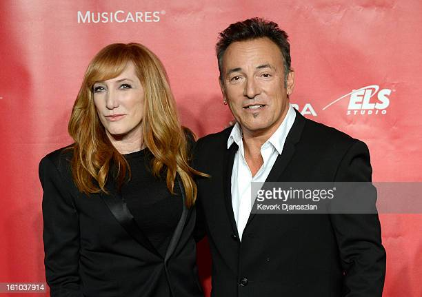 Honoree Bruce Springsteen and singer Patti Scialfa arrive at he 2013 MusiCares Person Of The Year Gala Honoring Bruce Springsteen at Los Angeles...