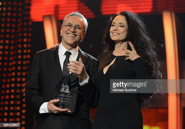 Honoree Caetano Veloso and actress Sonia Braga onstage during the 2012 Person of the Year honoring Caetano Veloso at the MGM Grand Garden Arena on...