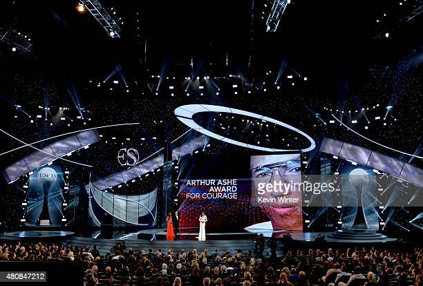 Honoree Caitlyn Jenner accepts the Arthur Ashe Courage Award from professional soccer player Abby Wambach onstage during The 2015 ESPYS at Microsoft...