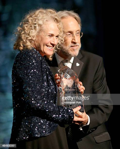 Honoree Carole King accepts MusiCares Person Of The Year award from CEO/President of the National Academy of Recording Arts Sciences Neil Portnow...