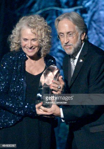 Honoree Carole King and CEO/President of the National Academy of Recording Arts Sciences Neil Portnow appear onstage at The 2014 MusiCares Person Of...