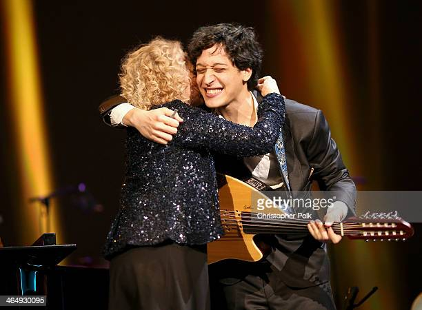Honoree Carole King and musician Ahmad El Haggar perform onstage at 2014 MusiCares Person Of The Year Honoring Carole King at Los Angeles Convention...