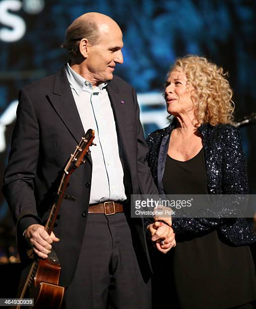 Honoree Carole King and musician James Taylor perform onstage at 2014 MusiCares Person Of The Year Honoring Carole King at Los Angeles Convention...