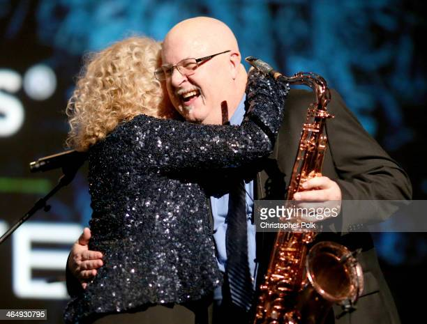 Honoree Carole King and musician Tom Scott perform onstage at 2014 MusiCares Person Of The Year Honoring Carole King at Los Angeles Convention Center...