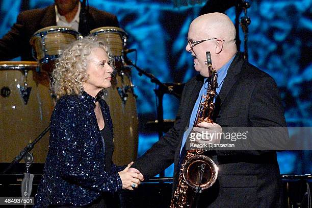 Honoree Carole King and musician Tom Scott perform onstage at The 2014 MusiCares Person Of The Year Gala Honoring Carole King at Los Angeles...