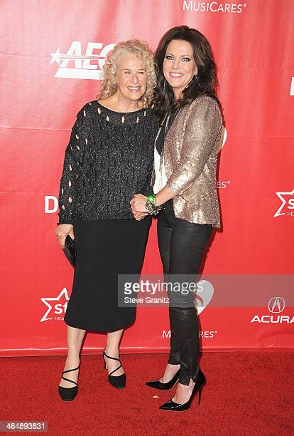 Honoree Carole King and singer Martina McBride attend 2014 MusiCares Person Of The Year Honoring Carole King at Los Angeles Convention Center on...