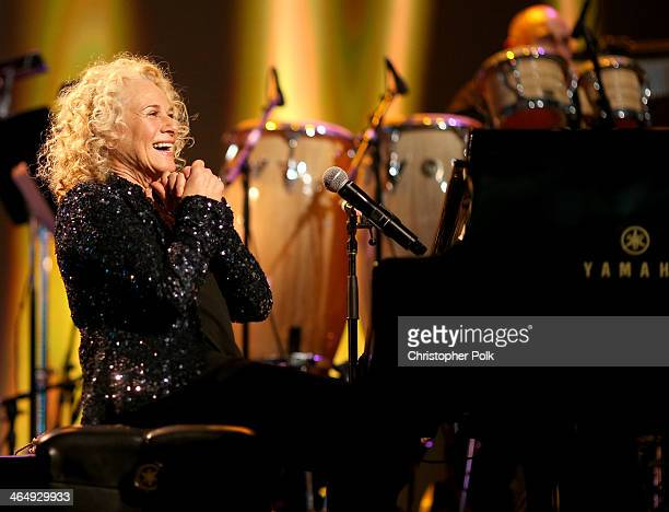 Honoree Carole King performs onstage at 2014 MusiCares Person Of The Year Honoring Carole King at Los Angeles Convention Center on January 24 2014 in...