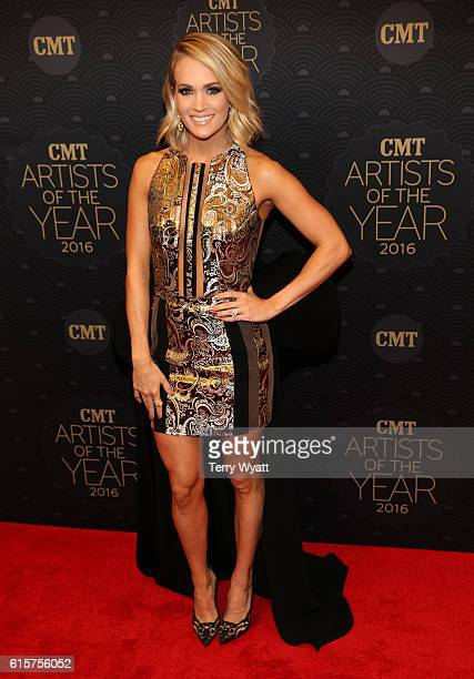 Honoree Carrie Underwood arrives on the red carpet at CMT Artists of the Year 2016 at Schermerhorn Symphony Center on October 19 2016 in Nashville...