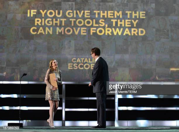 Honoree Catalina Escobar of the Juan Felipe Gomez Escobar Foundation and actor Rainn Wilson onstage during the CNN Heroes An All Star Tribute at The...