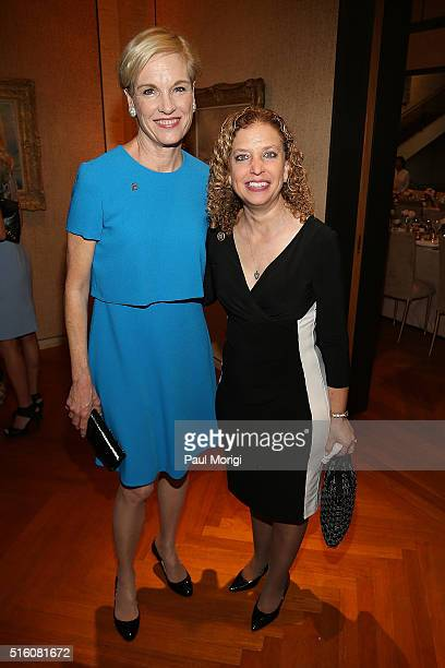 Honoree Cecile Richards and Rep Debbie Wasserman Schultz attend the ELLE and Hugo Boss Women in Washington Power List Dinner at the Kreeger Museum on...