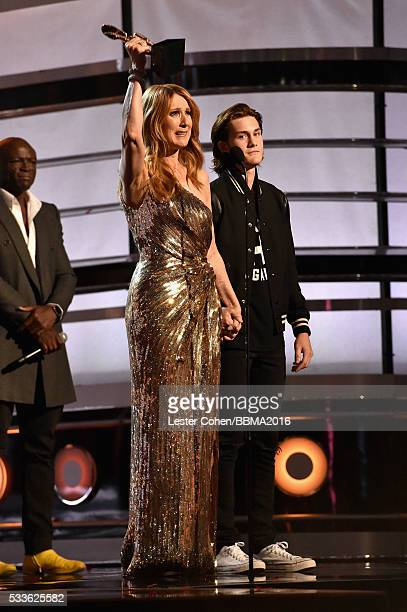 Honoree Celine Dion accepts the Icon Award from recording artist Seal and ReneCharles Angelil onstage during the 2016 Billboard Music Awards at...