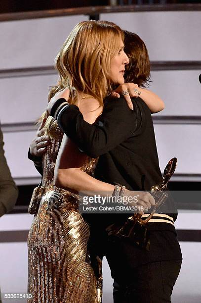 Honoree Celine Dion accepts the Icon Award from ReneCharles Angelil onstage during the 2016 Billboard Music Awards at TMobile Arena on May 22 2016 in...