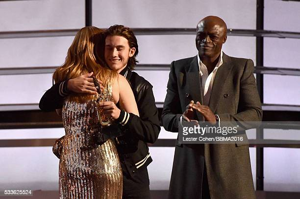 Honoree Celine Dion accepts the Icon Award from ReneCharles Angelil and recording artist Seal onstage during the 2016 Billboard Music Awards at...