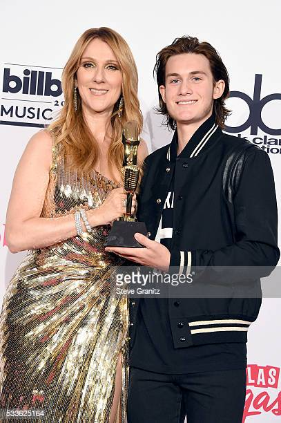 Honoree Celine Dion recipient of the Icon Award and ReneCharles Angelil pose in the press room during the 2016 Billboard Music Awards at TMobile...