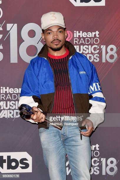 Honoree Chance The Rapper recipient of the Innovator Award poses in the press room during the 2018 iHeartRadio Music Awards which broadcasted live on...