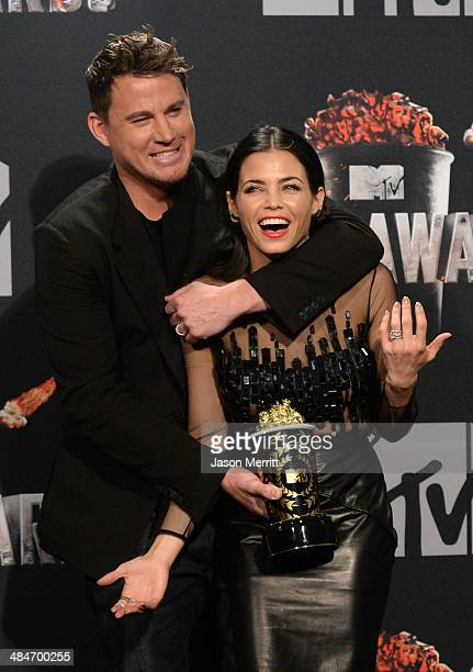 Honoree Channing Tatum and actress Jenna DewanTatum pose in the press room during the 2014 MTV Movie Awards at Nokia Theatre LA Live on April 13 2014...