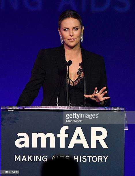 Honoree Charlize Theron accepts the amfAR Award of Inspiration onstage at amfAR's Inspiration Gala Los Angeles at Milk Studios on October 27 2016 in...