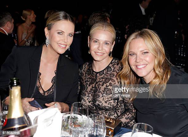 Honoree Charlize Theron TV personality Chelsea Handler and actress Mary McCormack attend amfAR's Inspiration Gala Los Angeles at Milk Studios on...