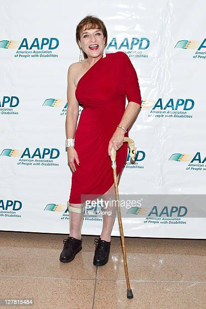 Honoree Cheryl Sensenbrenner wearing a Norma Kamali dress poses for a photo at the 2011 AAPD Awards Gala at the Ronald Reagan Building on March 15...