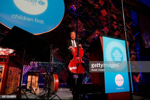 Honoree Children's Champion Award UN Messenger of Peace Cellist YoYo Ma performs on stage during UNICEF Children's Champion Award Dinner honoring...