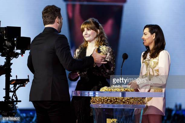 Honoree Chris Pratt accepts the MTV Generation Award from actors Bryce Dallas Howard and Aubrey Plaza onstage during the 2018 MTV Movie And TV Awards...