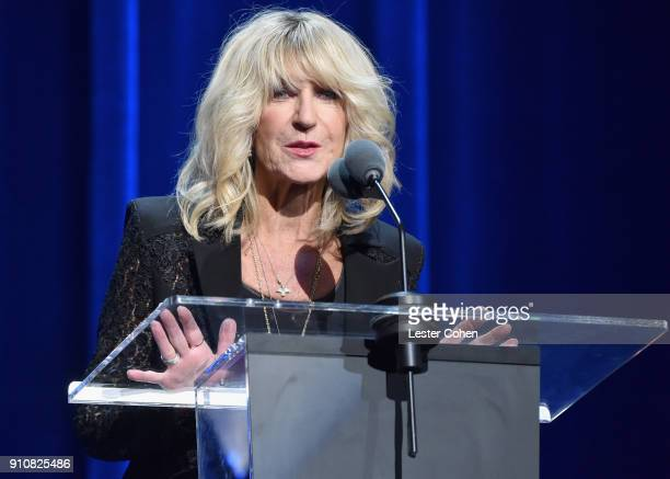Honoree Christine McVie of music group Fleetwood Mac accepts the MusiCares Person of the Year award onstage during MusiCares Person of the Year...