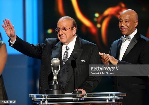 Honoree Clive Davis accepts the Vanguard Award from business magnate Russell Simmons onstage during the 46th NAACP Image Awards presented by TV One...