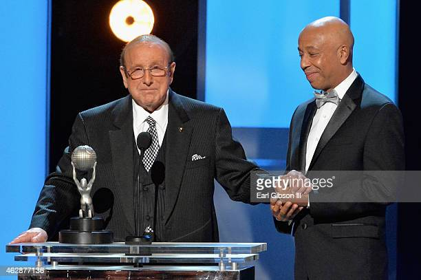 Honoree Clive Davis accepts the Vanguard Award from business magnate Russell Simmons onstage at the 46th Annual NAACP Image Awards on February 6 2015...
