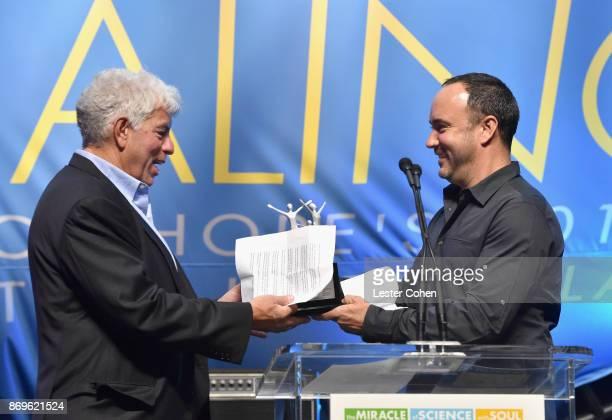 Honoree Coran Capshaw accepts the Spirit of Life Award from Dave Matthews at MFEI Spirit Of Life Honoring Coran Capshaw on November 2 2017 in Santa...