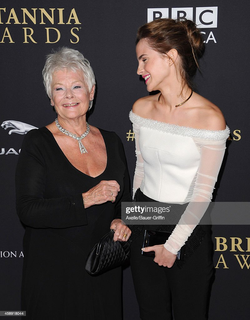 Honoree Dame Judi Dench (L) and actress Emma Watson arrive at the BAFTA Los Angeles Jaguar Britannia Awards at The Beverly Hilton Hotel on October 30, 2014 in Beverly Hills, California.