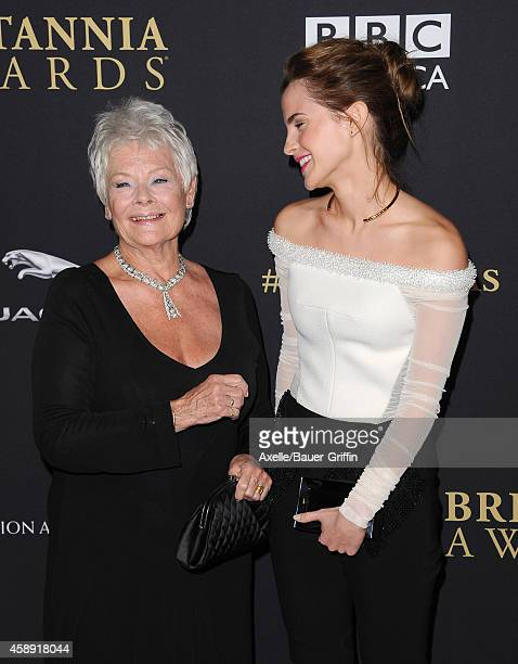 Honoree Dame Judi Dench and actress Emma Watson arrive at the BAFTA Los Angeles Jaguar Britannia Awards at The Beverly Hilton Hotel on October 30,...