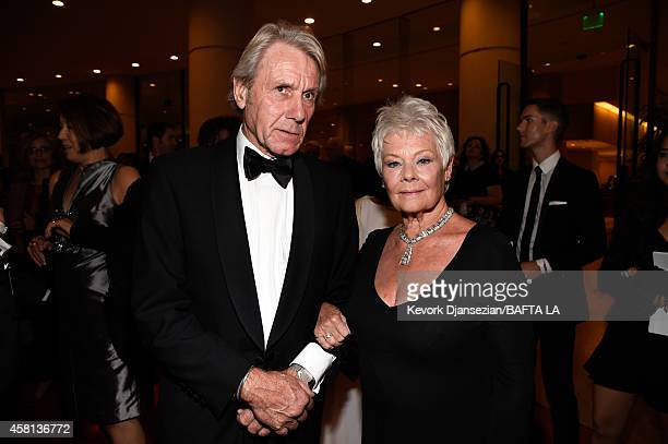 Honoree Dame Judi Dench and wildlife conservationist David Mills attend the BAFTA Los Angeles Jaguar Britannia Awards presented by BBC America and...