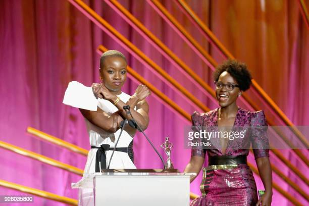 Honoree Danai Gurira and Presenter Lupita Nyong'o onstage during the 2018 Essence Black Women In Hollywood Oscars Luncheon at Regent Beverly Wilshire...