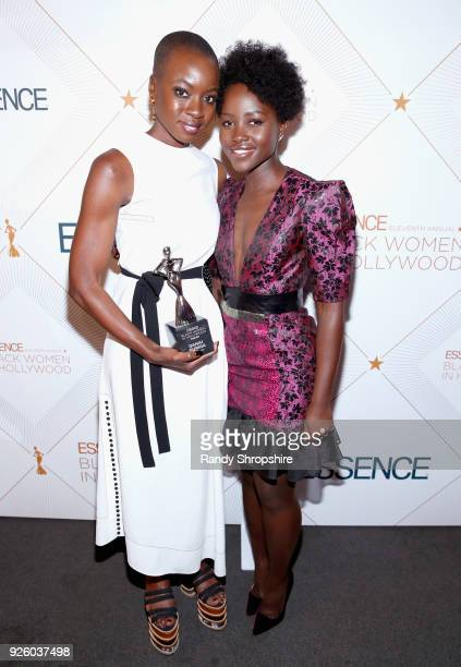 Honoree Danai Gurira and Presenter Lupita Nyong'o pose with award during the 2018 Essence Black Women In Hollywood Oscars Luncheon at Regent Beverly...