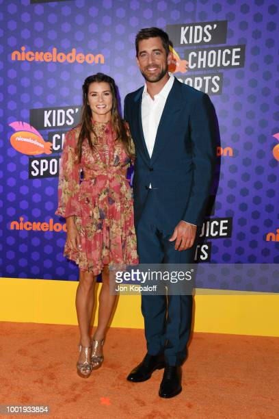 Honoree Danica Patrick and NFL player Aaron Rodgers attend the Nickelodeon Kids' Choice Sports 2018 at Barker Hangar on July 19, 2018 in Santa...