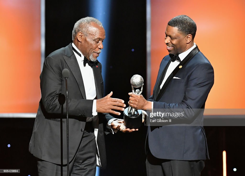 Honoree Danny Glover accepts the President's Award from president and CEO of the NAACP Derrick Johnson speaks onstage at the 49th NAACP Image Awards on January 15, 2018 in Pasadena, California.