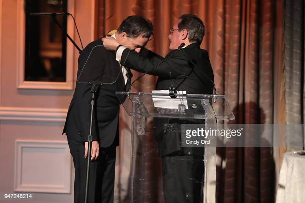 Honoree Derek McLane and host Andrew Farkas appear onstage as the Hasty Pudding Institute awards Derek McLane with the Order of the Golden Sphinx at...