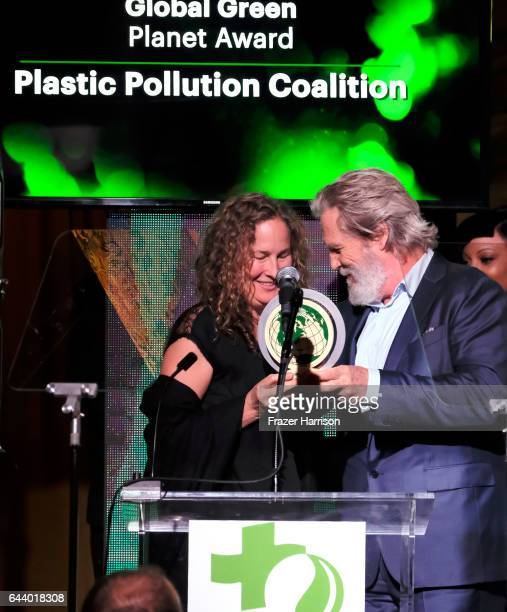 Honoree Dianna Cohen and actor Jeff Bridges speak onstage during the 14th Annual Global Green Pre Oscar Party at TAO Hollywood on February 22 2017 in...