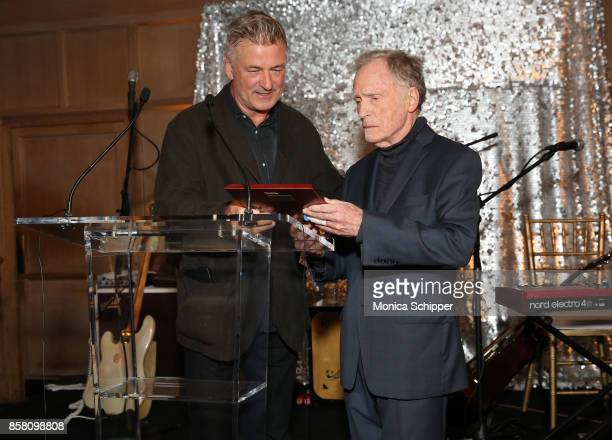 Honoree Dick Cavett accepts his award from Co Chair of the Hamptons International Film Festival Alec Baldwin during the Opening Night Party during...
